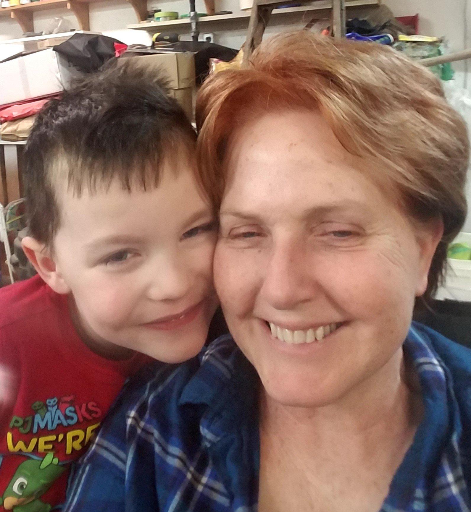 Website owner, Janelle, with grandson