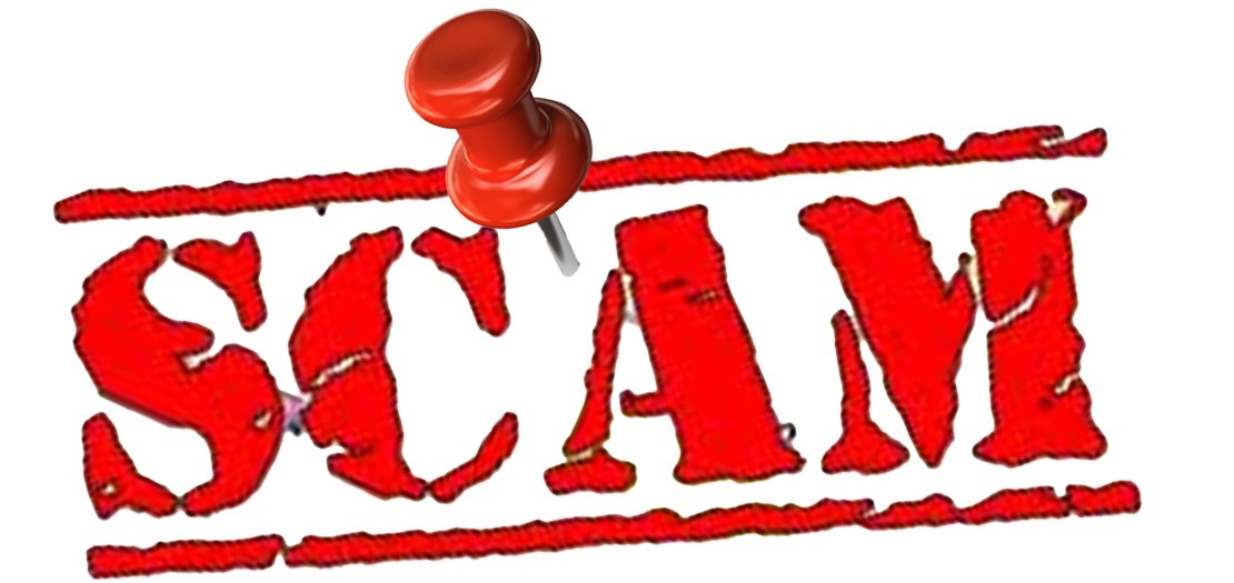 The word scam with pin in it
