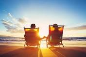 Couple watching sunset at the beach